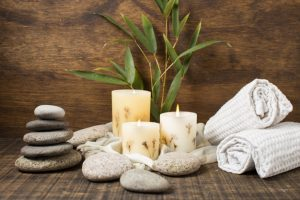 spa-concept-with-lit-candles-towels_23-2148268458